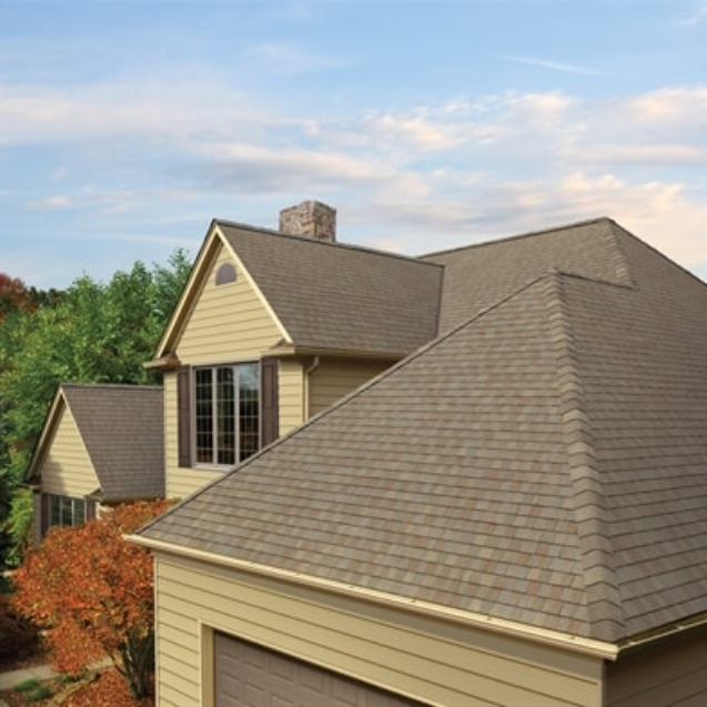 Photo of a home using GAF's Timberline American Harvest Amber Wheat shingles