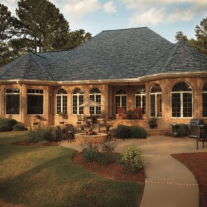 Photo displaying a home using GAF's Camelot Aged Oak Shingles